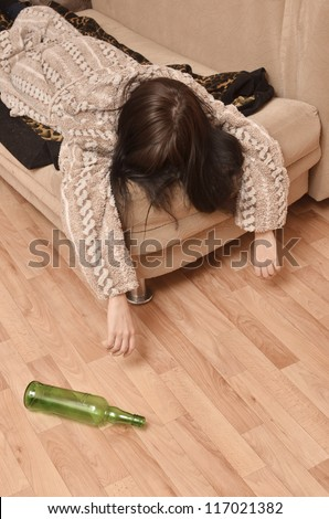 drunk woman sleeping on the sofa - stock photo