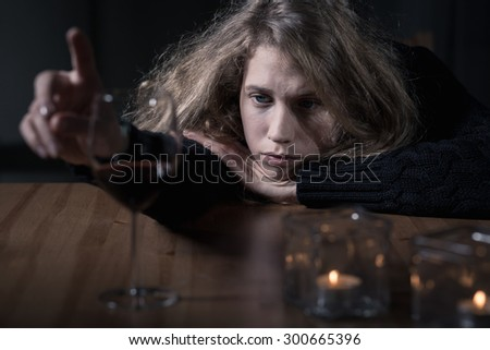 Drunk young woman and boring night - stock photo
