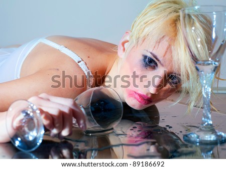 Drunk young woman with drinking glass - stock photo
