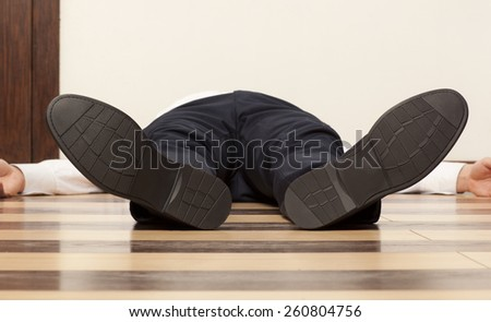 Drunkard. Young exhausted businessman lying on the floor - stock photo