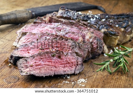 Dry Aged Barbecue Tomahawk Steak - stock photo