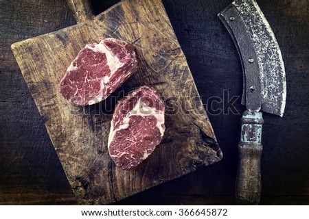 Dry aged Entrecote on Cutting Board - stock photo
