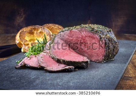 Dry Aged Roast Beef with Yorkshire Pudding - stock photo