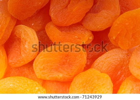 Dry apricots arranged at the background