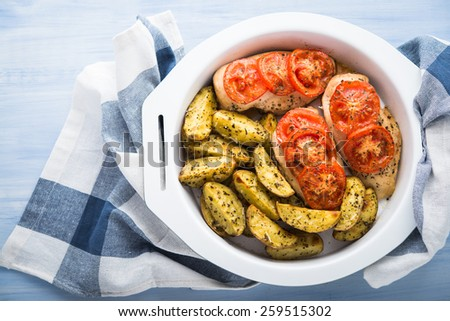 Dry basil parmesan fries and tomato chicken oven baked top view. - stock photo