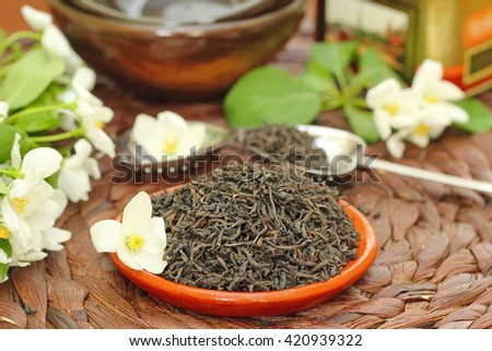Dry black tea leaves with jasmine aroma - stock photo