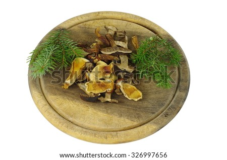 dry boletus on wooden plank isolated white - stock photo