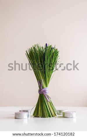 Dry bunch of lavender on the table over light background, with copy space