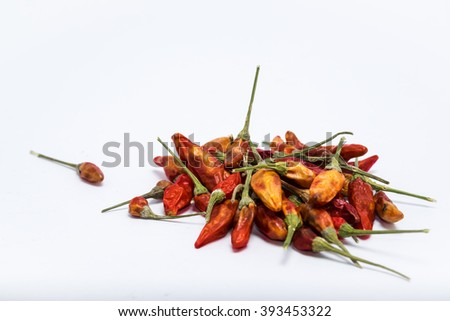 Dry chili on white background, close up