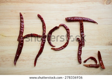 Dry chilli in lettering Hot  - stock photo