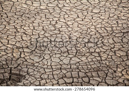 Dry crack soil texture - stock photo