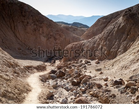Dry creek passing through hills, Death Valley National Park, California, USA - stock photo
