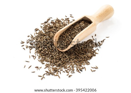 Dry cumin seeds in a wooden scoop on a white background  - stock photo