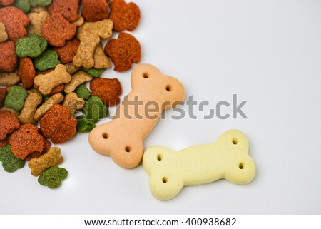 Dry dog food and dog biscuit bone on white background. - stock photo