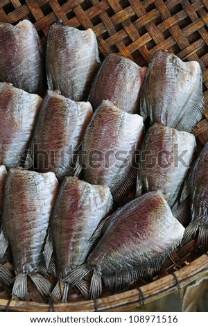 Dry fish on basket - stock photo