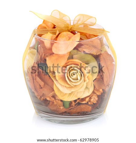 Dry flowers inside transparent glass bowl isolated on white background.