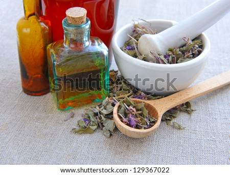 Dry herbal tea Chamerion is with tinctures in bottles on sackcloth, herbal medicine