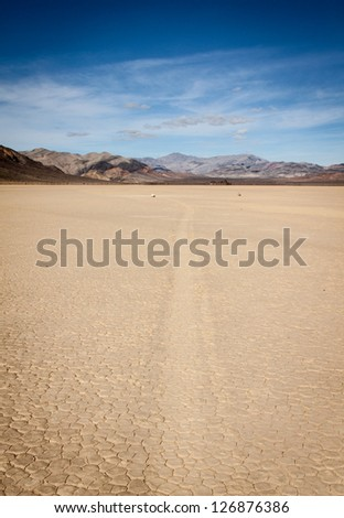 Dry hostile environment at the race track, death valley - stock photo