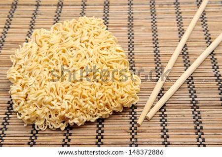 dry instant noodles and chopsticks - stock photo