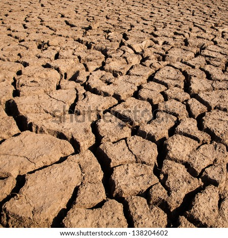 dry land with lack of water in thailand. This is symbol of dry season.Dried earth because of rain dose not fall and the land lacked of water for agriculture - stock photo