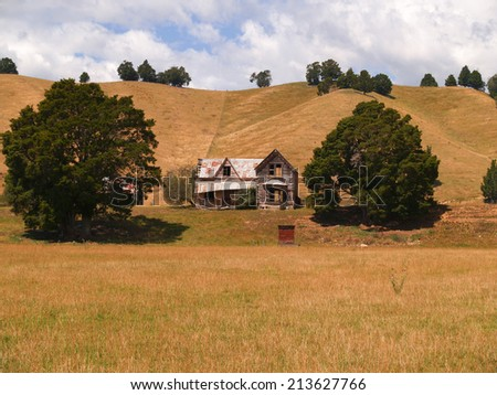 Dry landscape with deserted old home. - stock photo
