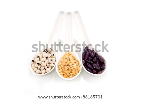 dry legumes on white spoon isolated white background