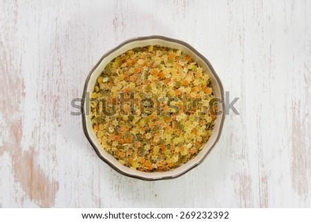 dry pasta in dish - stock photo