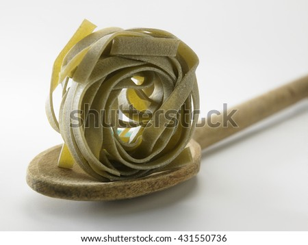dry pasta on the wooden table - stock photo