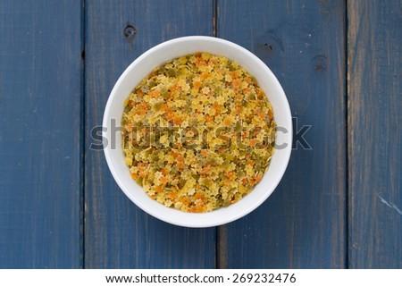 dry pasta stars in white bowl - stock photo