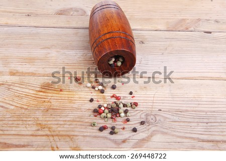 dry pepper with castor on wood - stock photo