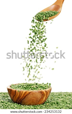 Dry raw organic chickpeas in wooden bowl with wooden scoop - stock photo