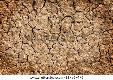 Dry red clay soil texture, natural floor background - stock photo