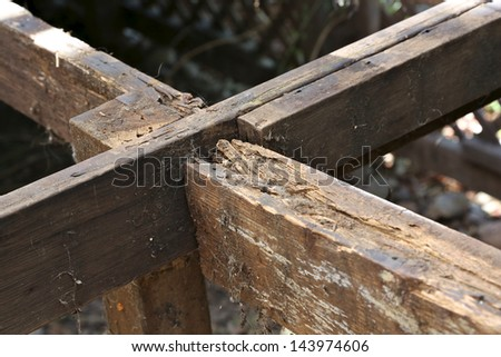 Dry rot in outdoor deck support - stock photo