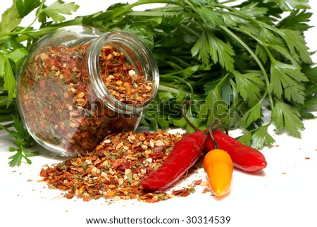 Dry seasoning with chillies and parsley - stock photo