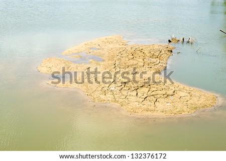 dry soil in the lake - stock photo