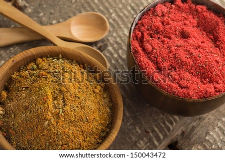 Dry spices in wooden bowls  on dark table.  Selective focus.