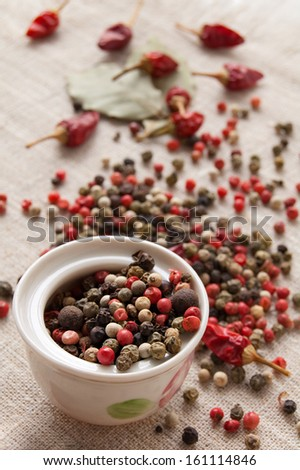 Dry spices, peppercorn and chili pepper on the coarse texture