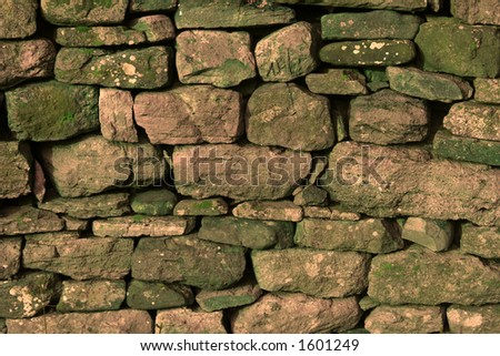 Dry Stone Wall Background Texture Digitally Mixed Green Cast - stock photo