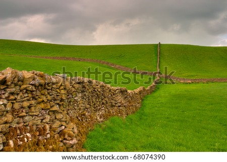 Dry stone wall on the fields in Yorkshire Dales in Great Britain - stock photo