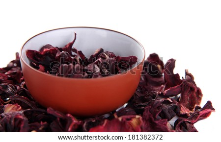 Dry tea in bowl isolated on white