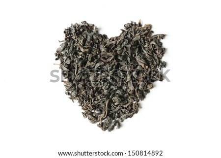 Dry tea leaves heart shape isolated on white background - stock photo
