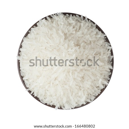 Dry uncooked rice in wooden bowl - stock photo