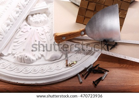 Dry wall and decoration of gypsum, screws for fastening, spatula