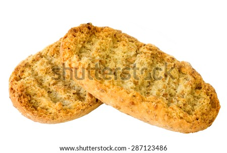 Dry wholegrain crusts (kavring) over white background - stock photo