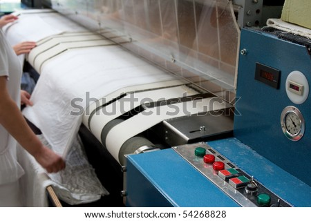 Drying and ironing rolling press - stock photo