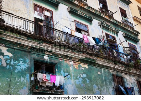 drying clothes on the balcony of the old building - stock photo