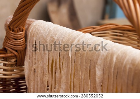 Drying homemade pasta on the wooden roller