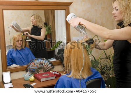 drying of red hair at home before the mirror - stock photo