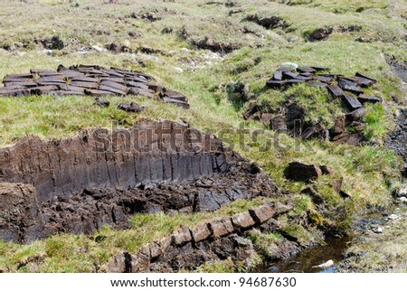 Drying peat in the highlands of cape Rua Reidh, Scotland - stock photo