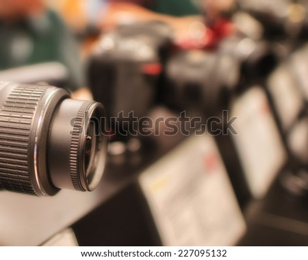 DSLR camera in a photographic shop. - stock photo